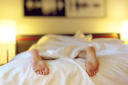 image of man sleeping on a bed